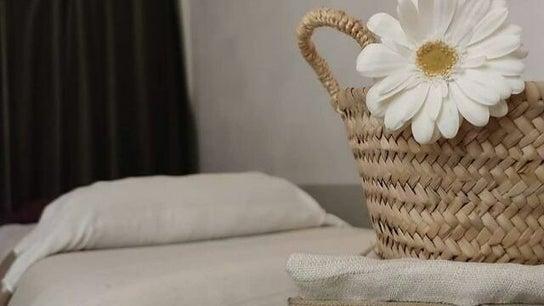 A. by anais neia  - Massage